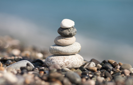 pile of white stones on the beach. Sea blurred background