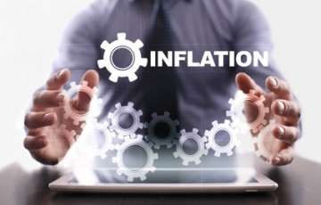 Businessman is using tablet pc and selecting inflation