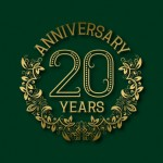 Golden emblem of twentieth years anniversary. Celebration patterned logotype with shadow on green.