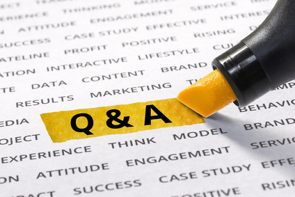 Q & A word highlighted with marker on paper of other related business word.