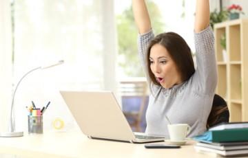 Euphoric and surprised winner winning online