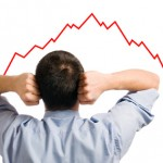 Young businessman looking at his declining share