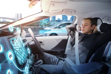 Caucasian man riding autonomous car. Self driving vehicle. Driverless car.